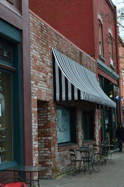 The exterior of Lulu's Restaurant, brick walls and awning.
