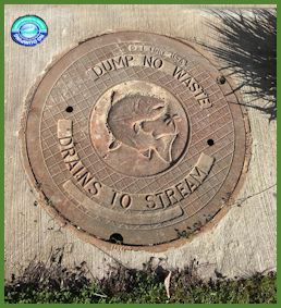 Manhole cover with Dump No Waste Drains to Stream on it